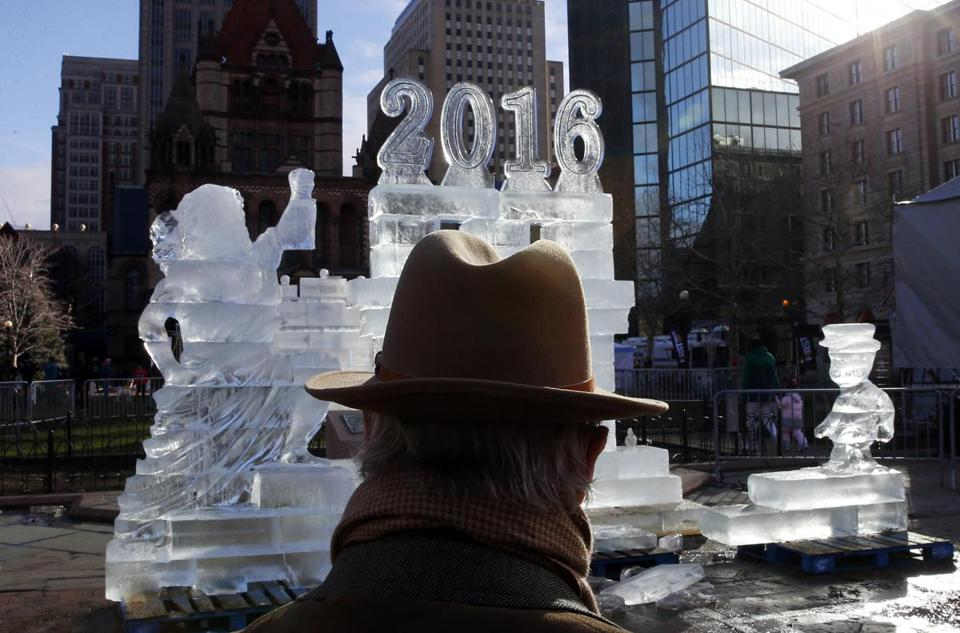 A man pauses to look at an ice sculpture in Copley Square on New Years Day in Boston, Massachusetts.